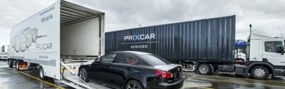 PrixCar Transport Services loading vehicle on truck