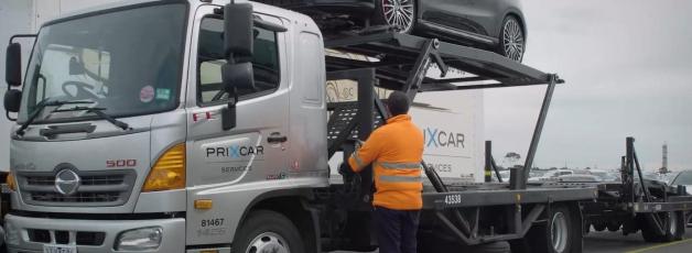 Loading a car on an auto car carrier